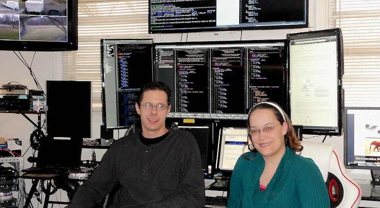 Katie and Brandon in office. Hash Tag The A Team Web site Design DevOps Javacript Stack Development FullStack